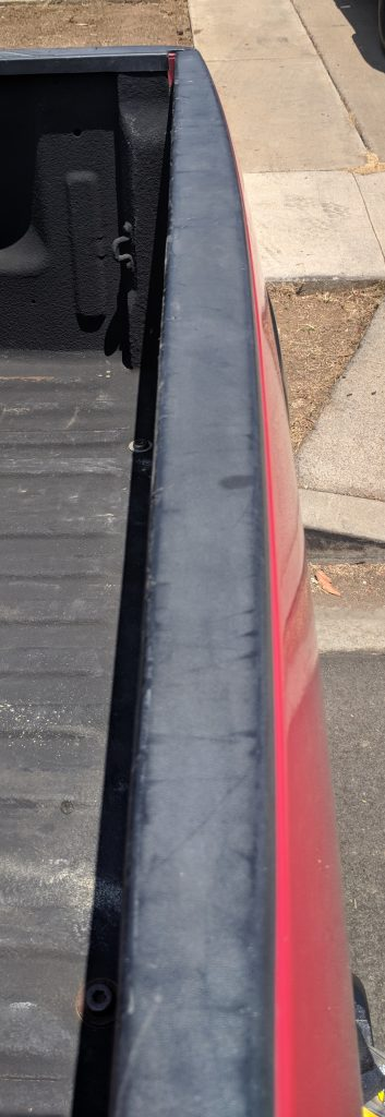 Tailgate Top Black Plastic Restorer Before